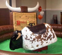 Hire a Rodeo Bull with themed inflatable mattress from Rodeobulls.co.uk